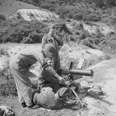 A member of the Home Guard receiving instruction on a machine gun at a training centre.
