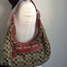 """Authentic Coach Signature C Large hobo bag Authentic with serial number, Coach Large Hobo bag, beige and brown signature C fabric, genuine red leather strap and bottom, red and clean inside, silver metals. Normal wear on the fabric, clean, good condition. 10"""" X 13"""" X 2"""" large.  No trades. No more discounts for this bag. Click the listings to see the boutique, Reduced prices in everything. $$$  Many lovely things, multiple item discounts $$$ Fabulous selection, better prices!! $10 and Up…"""