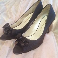 Caparros Violetta Brown Satin Heels Brown satin Violetta heels by caparros! 2 1/2 inch heel. Size 8. Peep toe with beautiful now detail. Never worn, new with box! Caparros Shoes Heels
