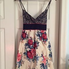 Mixed Floral Print Dress Lightly worn, great condition. Has adjustable straps, and bow at the empire waistline for a very cute and flattering fit. Xhilaration Dresses