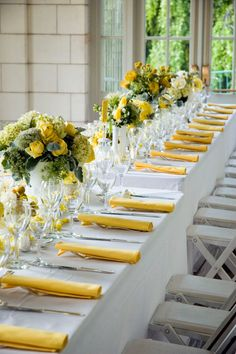 Yellow Wedding Reception Yellow napkins and green-and-yellow centerpieces popped against the white reception table linens. Wedding Centerpieces, Wedding Table, Wedding Decorations, Table Decorations, Wedding Ideas, Yellow Centerpieces, Reception Table, Decor Wedding, Budget Wedding