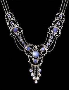 An Arts and Crafts Montana sapphire, moonstone and platinum necklace, by Louis Comfort Tiffany for Tiffany & Co., circa 1910. Signed Tiffany & Co. Collection of Nelson Rarities. Image source: Maker and Muse - ©The Richard Driehaus Museum #LouisComfortTiffany #ArtsAndCrafts #necklace