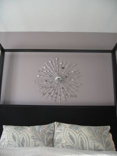 DIY How To Make Your Own Starburst Mirror using a convex mirror (car blind spot mirror),  cardboard disc,  dowel rods, skewers, Permanent marker, Mounting hardware, Ruler, Silver-leaf water-based gold-leaf, Sizing brushes, Hot glue, and Round mosaic mirrors.    #midcentury   #modern #decor