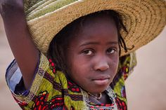 portrait of a little girl in front of  great mud mosque in the bani, in the tribal region of the Sahel, northern Burkina Faso by anthony pappone photographer, via Flickr