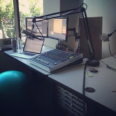 Dan Benjamin's podcast station; condenser microphone, Apple Mac Laptop.