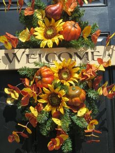 Fall Door Swag Wreath, Welcome Wreath, Sunflower Wreath, Autumn Wreaths, Fall Door Wreaths, Door Wreaths, Thanksgiving Wreaths, Home Decor, Front Door Wreaths, Outdoor Wreaths, Fall Wreath for Door, Grapevine Wreaths, Silk Floral Wreaths, Fall Decor, Fall Door Decor  This lovely fall swag was designed around a wooden welcome sign that has the word Welcome carved out of the wood. The sign measure 24Lx4H, was lightly stained natural, with the letters and stars left natural wood. The base is…