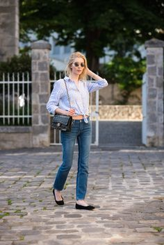 Chanel flap bag and linen striped shirt