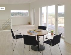 The 141 is very spacious, at the same time, built to be the most energy efficient. Here in the picture, the reading table overlooks a veranda in a well lit room. Reading Table, Energy Efficiency, Nova, Conference Room, Building, Furniture, Home Decor, Energy Conservation, Decoration Home