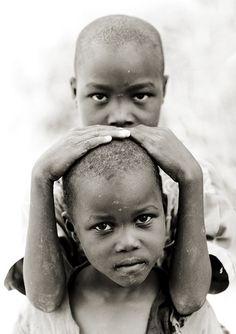 Tharaka boy protecting his brother - Kenya