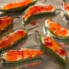 Jalapeno Poppers with cream cheese and red pepper jelly...would be awesome with sweet chili sauce too....
