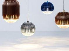 Round Fin pendant lamps by Tom Dixon. These innovative lights are available in blue, copper, aluminum and gold.