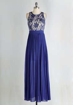 Whether you describe this sapphire blue maxi as alluring, enchanting, captivating, or all of the above, one thing is certain - when you fasten its exposed silver zipper on your frame, flaunt the illusion neckline above its ivory lining, and feel its pleated skirt twirl about, you encapsulate every compliment!