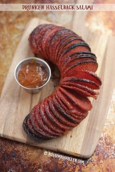 Drunken Hasselback Salami - accordion-sliced baked salami with an apricot brandy sauce : busyinbrooklyn Finger Food Appetizers, Appetizers For Party, Appetizer Recipes, Salami Appetizer, Finger Foods, Kosher Recipes, Meat Recipes, Cooking Recipes, Snacks