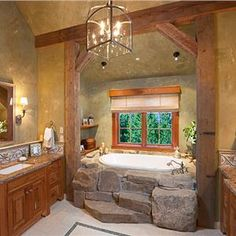 I love how the bath tub looks!! And I love how it is framed by wooden beams.