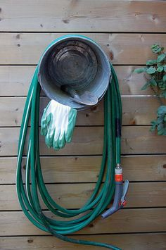 galvanized steel bucket to hang garden hose, store gloves. Karen rocks.