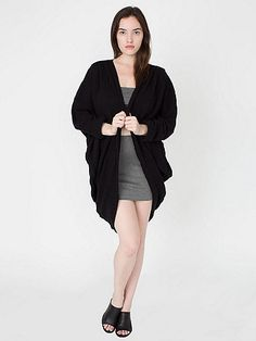 A slouchy, oversized cardigan in a lightweight and loosely woven Bouclé yarn.