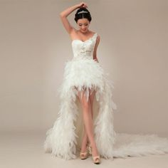White peacock wedding dress robe de mariée paon