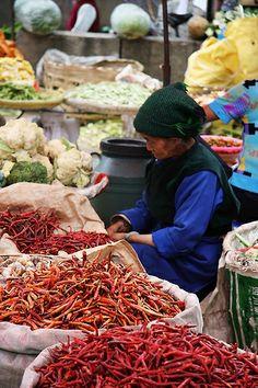 Spice merchant in a market near Dali in Yunnan, China