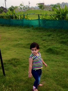 Walking on the grass @ Eco Park. I am born with Attitude !
