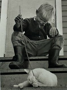 Ismo Hölttö, Boy playing with Finnish cat, Hailuoto, 1964 Bw Photography, Lead Role, Boys Playing, Make Me Smile, Monochrome, Photos, Photographs, Illustration, Black And White