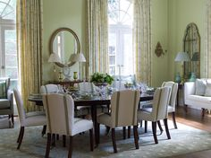 MrsHoward.com - lovely as always! Like the serene green color palette & the green trim detail on the chairs.