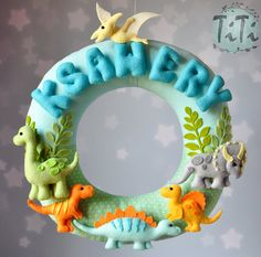Personalized name garland / wreath, felt dinosaur theme , wall decor, baby, nursery decor,  Triceratops, T-Rex, Stegosaurus, Brontosaurus
