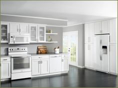 Cream Colored Kitchen Cabinets With White Appliances