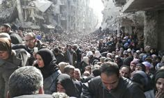 Residents wait to receive food aid distributed by the UN at al-Yarmouk camp, Damascus, 310114