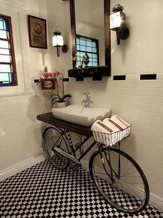 Looking at this charming bathroom with a creative twist, a bicycle sink. Would you ever use a bike and transform it into a bicycle sink in your bathroom? I think the black & white tile floor and b Bicycle Sink, Old Bicycle, Old Bikes, Bicycle Decor, Bicycle Basket, Bicycle Wheel, Tandem Bicycle, Cruiser Bicycle, Vanity Sink