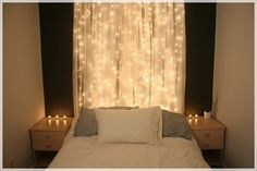 A romantic alternative to a headboard--string lights and curtains. #DIY #headboard #bedroom #apartment #decorating #decor