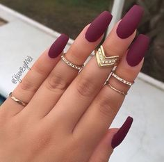 This trend has blown up especially after Kylie started showing off her maroon nails. To glam it up even further, ask for spring inspired floral design or a chevron pattern on one nail. Knuckle rings are a must! | Nail Designs |