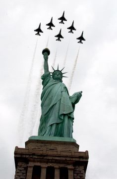 Six F-16 Fighting Falcons with the U.S. Air Force Thunderbirds aerial demonstration team fly in formation over the Statue of Liberty before an air show May 26, 2005. (U.S. Air Force photo by Staff Sgt. Josh Clendenen)