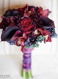Purple cala lillies with dark red roses love!