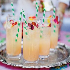 """A Ladylike Tea   Present Signature Cocktails   Take the time to do the extras such as polish silver and crush ice. """"A party is a gift of hospitality and friendship, so put your effort into it,"""" Danielle says. Add whimsy to drinks with striped straws and edible rose petals."""