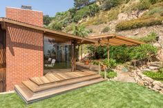 The redwood-sheathed residence has five bedrooms and is available for the first time since Kameon also designed the Sunset Strip hotel now known as the Standard. Malibu For Sale, Midcentury Modern, Pergola, Mid Century, Outdoor Structures, House Design, Patio, Herb, Sunset
