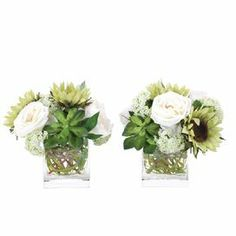 """Bring organic elegance to your decor with this lovely faux sunflower and echeveria arrangement, nestled in a glass vase from Natural Decorations, Inc. Made in the USA.  Product: Set of 2 faux floral arrangementsConstruction Material: Glass and silkColor: Green and whiteDimensions: 9"""" H x 11"""" W x 11"""" DNote: This product is supplied by Natural Decorations Inc."""