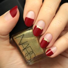 Red nails are always a must, but with pretty gold bows, AND a negative space design, our Red and Gold Bow Nail Tutorial is too good to pass up!