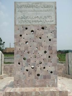 Front of the monument wall, depicting holes as the entry point wounds of the projectile (bullets). 60 lives for the glory of motherland. 35 FF monument at Jarpal