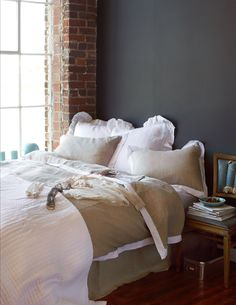 The romantic ruffles on this quaint bedding creates such a lovely, vintage atmosphere.