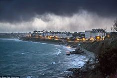 Like a painting: A storm approaches the seafront at Falmouth, Cornwall, just after sunset last night  Read more: http://www.dailymail.co.uk/news/article-2534511/UK-weather-50ft-waves-hit-coast-1-6inches-rain-fall-sodden-ground-today.html#ixzz2rw5TppIA