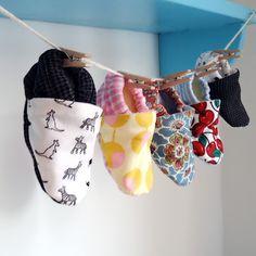 Baby booties by Chichidee Handmade I love this display. <3 @Heather Clark