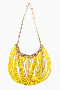 Love this jewelry DIY inspiration of bright neon yellow tiny beaded lengths looped and hanging from a chunky gold chain! Would look great in any color bead really!