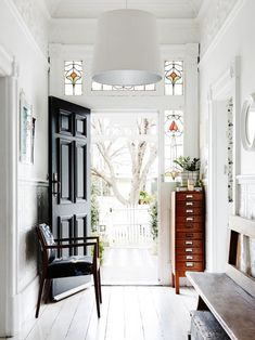 Pretty Hallway! Cute nightstand! Check out the rest of this colorfull home at - Roomed | roomed.nl