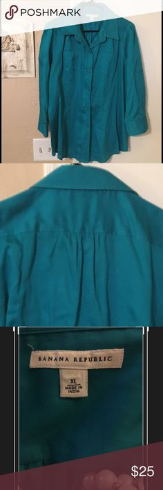 Turquoise blue Banana Republic button up XL Turquoise blue Banana Republic button up XL with option to roll up and button sleeve. Two pockets on front. Excellent condition. (Pearls not included) Banana Republic Tops Button Down Shirts