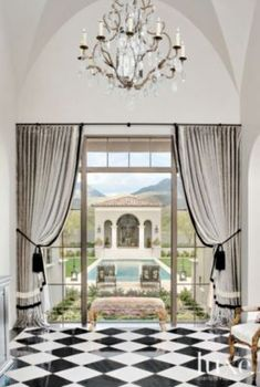 The Millionairess of Pennsylvania: Formality starts in the foyer, with its straight-through view of the 65-foot-long pool and striking guesthouse.