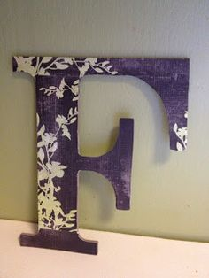 """I am digging this letter covered in scrapbook paper also on website is the formula for homemade """"Modge Podge"""""""