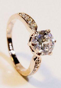 http://www.sheinside.com/Fashion-Gold-Diamond-Ring-p-185906-cat-1759.html