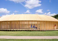 Ring-shaped pavilion of wooden walkways in Copenhagen castle grounds.