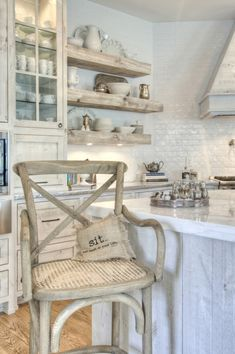love the white kitchen, the chair and even the little pillow