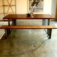 We ordered this table from Croft House a couple of years ago - Railcar Table.  It's made from reclaimed wood and steel.  It arrived promptly and it totally built to last.